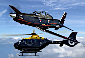 Image of a Becchcraft Texan T6 and Juno Helicopter.